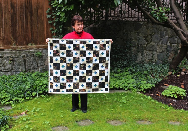 Mum with quilt in garden